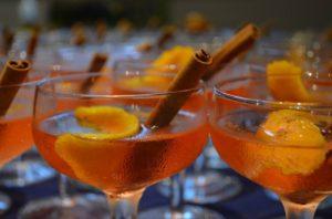 orange cocktails with cinnamon stick and orange slice